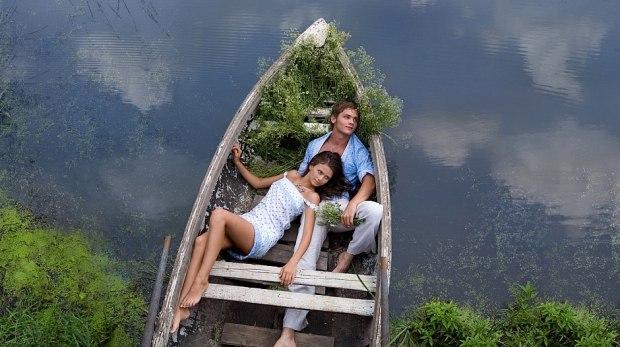 плыву на лодке по реке сонник